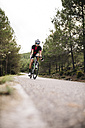 Cyclist riding a bike on a road - JRFF000154