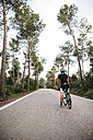 Cyclist with a bike on a road - JRFF000163