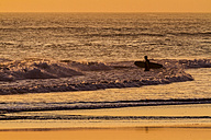 Indonesia, Bali, surfer on Kuta beach at sunset - KNT000154