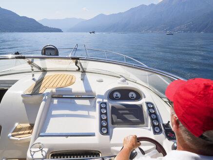Switzerland, Ticino, Lago Maggiore, senior man on boat - LAF001530
