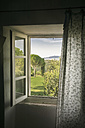 Italy, Tuscany, Maremma, view out of window to rural landscape - RIBF000334