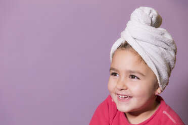 Portrait of smiling little girl wearing towel turban - ERLF000071