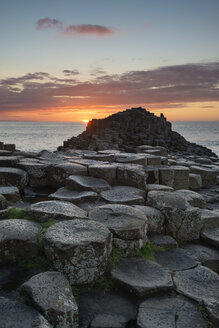 United Kingdom, Northern Ireland, County Antrim, View of causeway coast, Giant's Causeway at sunset - ELF001703