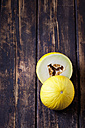 Two halves of honeydew melon on dark wood - CSF026660