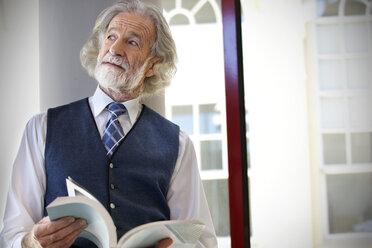 Senior professor holding book - RMAF000170