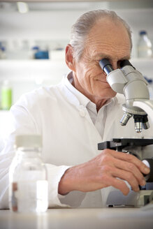 Professor in laboratory examining samples under microscope - RMAF000194