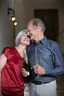 Senior couple celebrating with champagne - RMAF000215