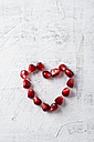 Heart shaped of pomegranate seeds - MYF001197