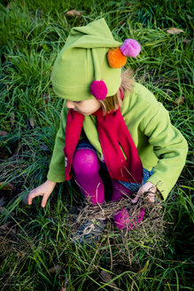 Little girl playing on a meadow in autumn - LVF004112