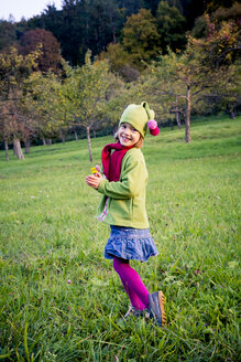 Germany, Baden-Wuerttemberg, smiling little girl on a meadow in autumn - LVF004121