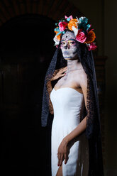 Woman dressed as La Calavera Catrina, Traditional Mexican female skeleton figure symbolizing death - ABAF001944