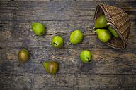 Wickerbasket of organic Bonne de Longueval on dark wood - LVF004134