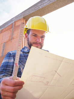 Portrait of foreman with construction plan and pocket rule - LAF001541