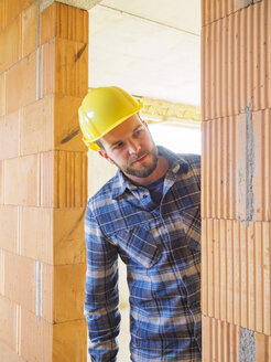 Portrait of foreman checking construction work - LAF001550