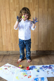 Portrait of creative little boy with palms full of finger colours - KIJF000008