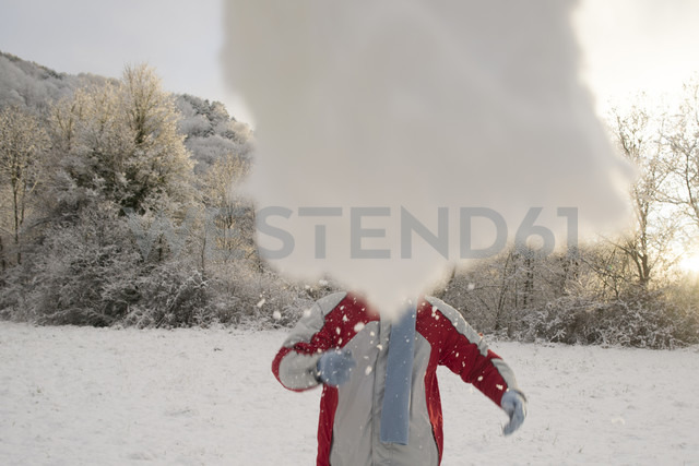 Man throwing a snowball in park - SKCF000023