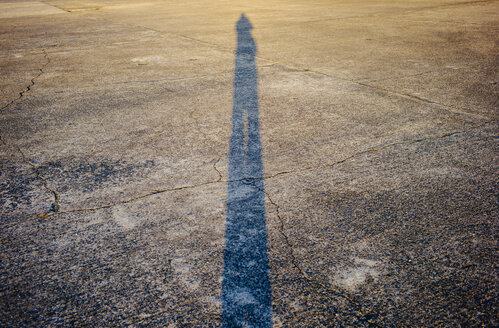 Shadow of person on cracked runway - DASF000017