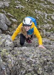 UK, Lake District, Great Langdale, woman scrambling at Pike of Stickle - ALRF000102