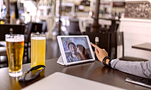 Photography of young couple on display of digital tablet - MGOF001002