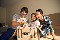 Happy family with dog inside cardboard box - TOYF001415
