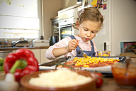 Girl in kitchen preparing pizza - TOYF001430
