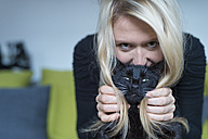 Portrait of blond woman and her black cat - FRF000359