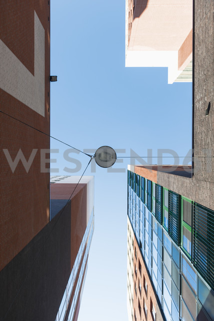 Netherlands, Roermond, view to facades of office tower and high-rise residential building from below - VIF000442