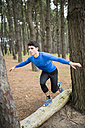Athlete exercising balance in forest - RAEF000632