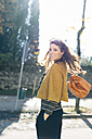 Stylish woman at the park on a sunny autumn day - GIOF000469