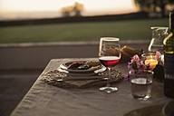 Italy, Tuscany, Dinner at sunset - RIBF000386