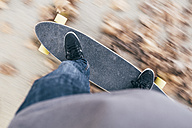Young man driving longboard - JRFF000178
