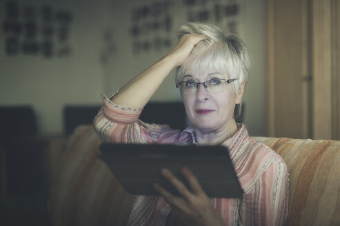 Portrait of senior woman with digital tablet - FRF000362