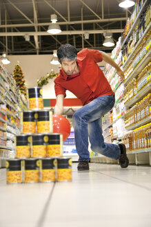 Man bowling in a supermarket - RMAF000235
