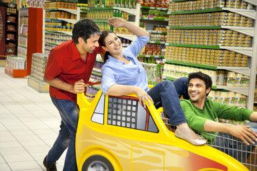 Three friends having fun together in a supermarket - RMAF000238