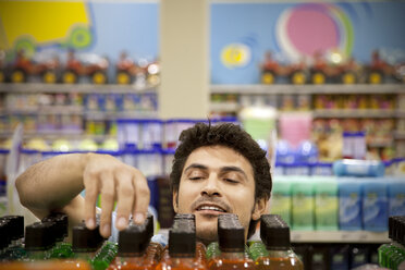 Portrait of a man searching product in a supermarket - RMAF000247