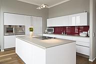 Interior of modern flat, Kitchen with freestanding kitchen block - FKF001522