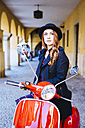 Italy, Verona, young woman with scooter - GIOF000523