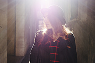 Italy, Verona, young woman in the city in back light - GIOF000541