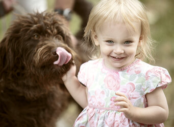 Portrait of smiling  blond little girl with her dog - NIF000053
