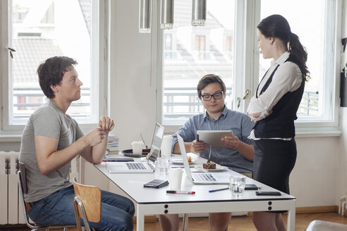 Three creative business people having a meeting in a modern office - JUBF000059