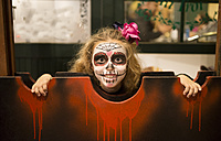 Blond little girl with sugar skull makeup at Halloween - RAEF000666