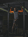 Physical athlete at power rack doing abdominal training - MADF000627