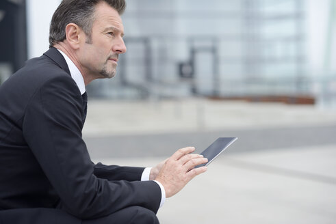 Young businessman using digital tablet - GUFF000170