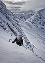 UK, Scotland, Glencoe, West Face Aonach Mor, woman ice climbing - ALRF000162