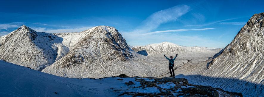 UK, Scotland, Glencoe, Glen Etive, woman cheering in winter landscape - ALRF000165