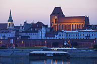 Poland, Torun, view to city skyline at dusk - ABOF000043