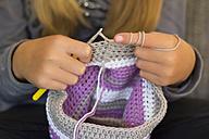 Girl crocheting a cap, close-up - YFF000483