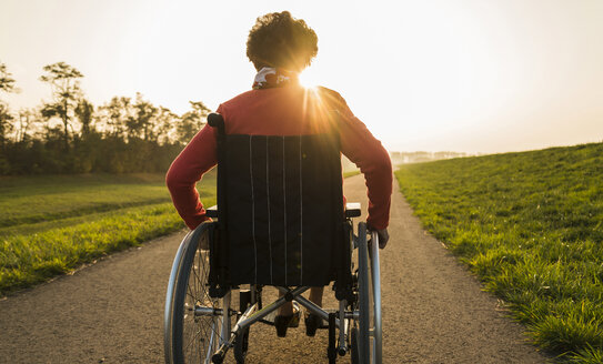 Senior woman in wheelchair in the nature - UUF006149