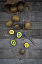 Green and golden kiwis on wood - LVF004174