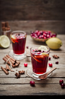 Glass of cranberry juice with fresh cranberries, lemon slices and spices - CZF000231